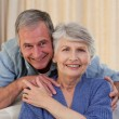 Stock Photo: Mature mhugging his wife
