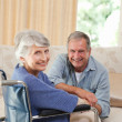 Mature couple looking at the camera — Stockfoto
