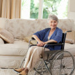 Stock Photo: Retired womin her wheelchair