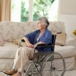 Retired woman in her wheelchair — Stock Photo