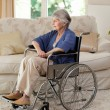 Retired woman in her wheelchair — Foto Stock