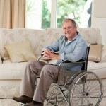 Senior man in his wheelchair — Stock Photo #10846947