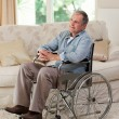 Stock Photo: Senior min his wheelchair