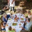 Family eating in the garden — Stock Photo #10846982