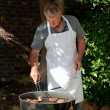 Handsome man having a barbecue in the garden — Stock Photo #10846986
