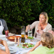Lovely family eating in the garden — Stock Photo #10846988
