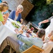 Lovely family eating in the garden — Stock Photo #10846990