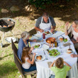 Adorable family eating in the garden — Stock Photo #10847004