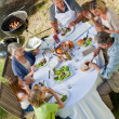 Adorable family eating in the garden — Stock Photo #10847006