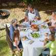 Adorable family eating in the garden — Stock Photo #10847007