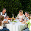 Adorable family eating in the garden — Stock Photo #10847008