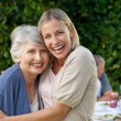 Mother with her daughter looking at the camera in the garden — Stock Photo