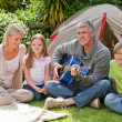 Happy family camping in the garden — Stock Photo