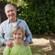 Stock Photo: Boy with his Grandfather looking at camera