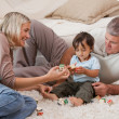 Son playing with his parents — Stock Photo #10847158