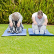 Senior couple doing their streches — Stock Photo #10847189