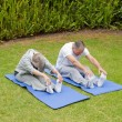 Senior couple doing their streches — Stock Photo #10847196