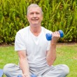 Retired man doing his exercises in the garden — Photo