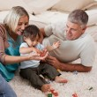Son playing with his parents — Stock Photo