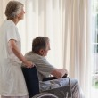 Retired couple looking out the window — Stock Photo