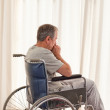 Thoughtful man in his wheelchair — Stock Photo