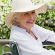 Stock Photo: Mature womin her wheelchair in garden