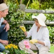 Mature couple working in the garden — Stock Photo #10847692
