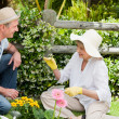 Stock Photo: Mature couple working in the garden