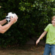 Grandfather and his grandson playing football — Foto Stock
