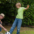 Grandfather and his grandson playing football — Stock Photo