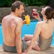 Happy couple drinking cocktails — Stock Photo