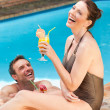 Stock Photo: Smiling couple drinking cocktails