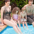 Happy family beside the swimming pool — Stock Photo #10848065