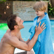 Stock Photo: Father with his son beside swimming pool