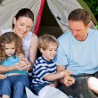 Royalty-Free Stock Photo: Adorable family camping in the garden
