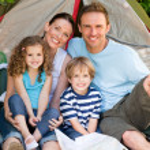 Adorable family camping in the garden — Stock Photo