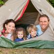 Joyful family camping in the garden — Stock Photo