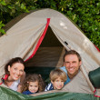Joyful family camping in the garden — Stock Photo