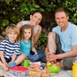 Royalty-Free Stock Photo: Happy family picnicking in the garden