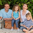 Happy family picnicking in the garden — Stock Photo #10848190