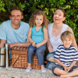 Happy family picnicking in the garden — Stock Photo