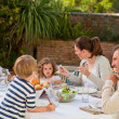 Family eating in the garden — Stock Photo #10848217