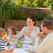 Family eating in the garden — Stock Photo #10848221