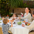 Adorable family eating in the garden — Stock Photo #10848231