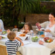 Adorable family eating in the garden — Stock Photo