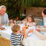 Adorable family eating in the garden — Stock Photo