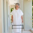 Senior woman with her zimmer frame — Stock Photo