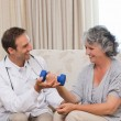 Handsome doctor helping his patient to do exercises - Stock Photo