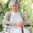 Retired woman with her walking stick - Stock Photo