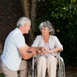 Stock Photo: Mature couple in garden